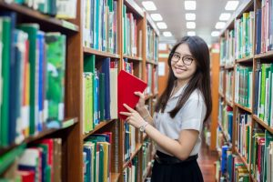 Asian student at the library